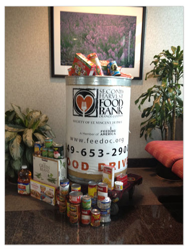 Employees collect food for those less fortunate in their community to benefit Island Harvest, Second Harvest Food Bank, and more