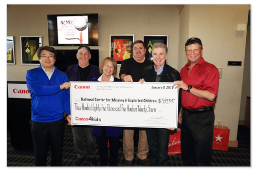 Canon presents a donation to the National Center for Missing & Exploited Children at the Celebrity Golf Tournament.