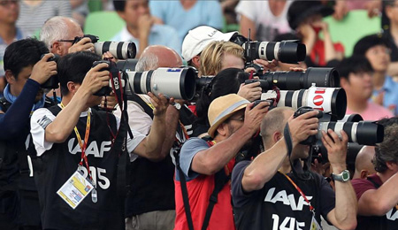 Photographers shoot the August 2011 IAAF World Championships in Daegu, South Korea. (Photo: Michael Steele/Getty Images)