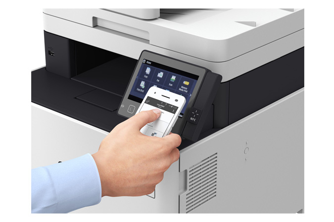Color imageCLASS MF745Cdw multifunction laser printer - person using NFC on phone to print