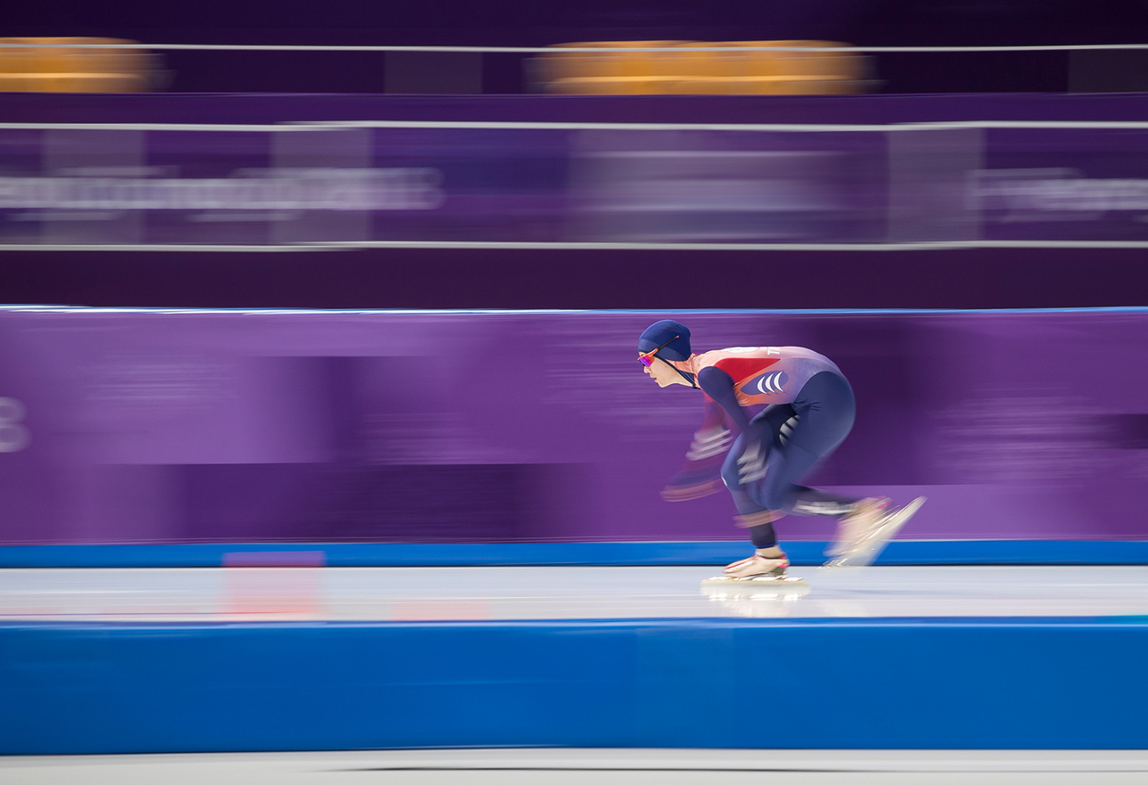 An ice skater in race