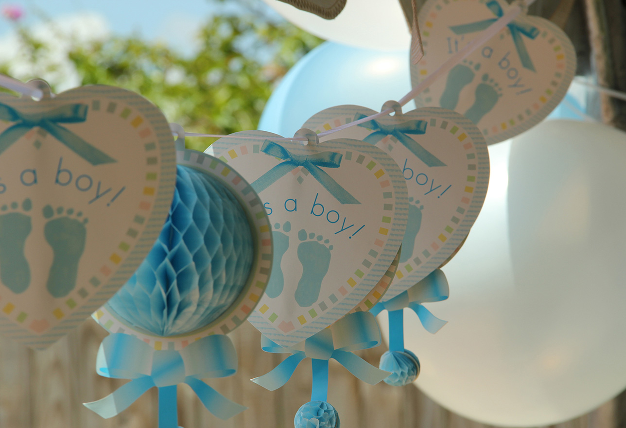 string of it's a boy blue heart decorations and balloons