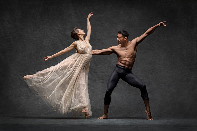 Male and female ballet dancers posing